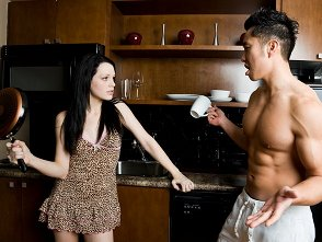 couple arguing in kitchen